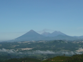 View of the Agua, Fuego and Acatenango volcanoes on the way to El Guatalón and Annexes.